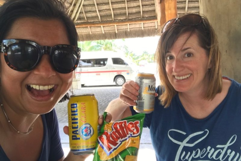 Stella and Fadra - snagging a beer and snack in Cozumel