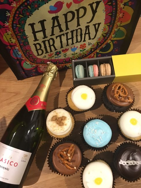 Getting-the-birthday-party-started-right-by-brining-gifts-cupcakes-macarons-and-champagne-with-us-to-our-room-at-the-Durham-Hotel.-488x650